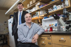 Kurt Rote, left, CEO of Western Oncolytics and Dr. Stephen Thorne, University of Pittsburgh in Dr. Thorne's research lab at the Hillman Cancer Center.